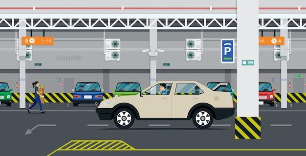 운전 기사가 건물 내 주차장을 찾고 있습니다.