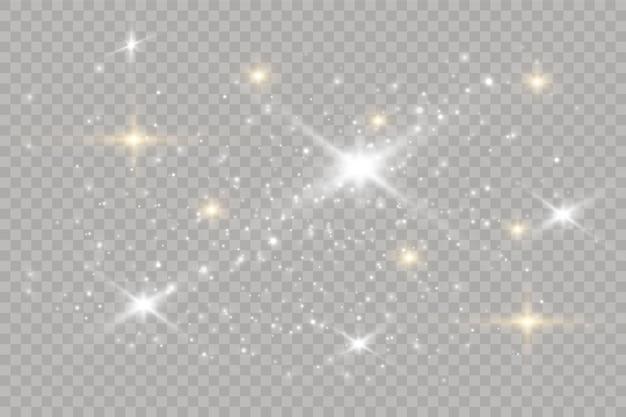ほこりは白いです。白い火花と金色の星が特別な光で輝いています。透明な背景にベクトルがきらめきます。クリスマスの抽象的なイラスト。きらめく魔法のほこりの粒子。