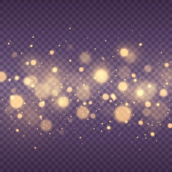ほこりの火花と金色の星が特別な光を放つ黄色のボケサークルで輝きます