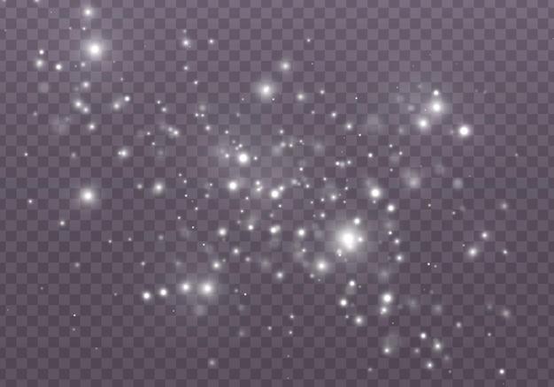 ほこりの火花と金色の星が特別な光で輝いています。光の効果。雪。 。概要。魔法の概念。ボケ効果のある抽象的な背景。