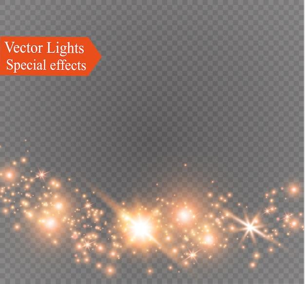 Искры пыли и золотые звезды сияют особым светом. сверкает на прозрачном фоне. рождественский световой эффект. сверкающие магические частицы пыли.