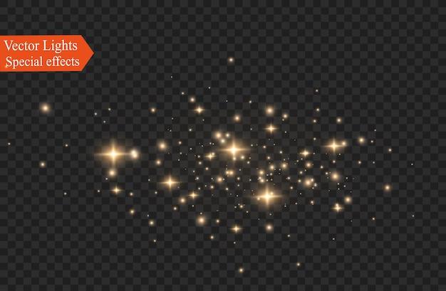 ほこりの火花と金色の星が特別な光で輝いています。透明な背景にきらめきます。クリスマスライト効果。
