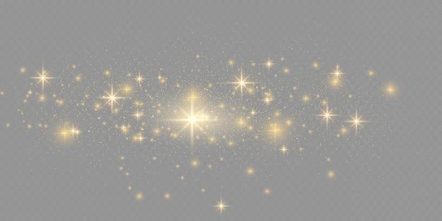 ほこりの火花と金色の星が特別な光で輝いています。透明な背景にベクトルがきらめきます。クリスマスライト効果。きらめく魔法のほこりの粒子。
