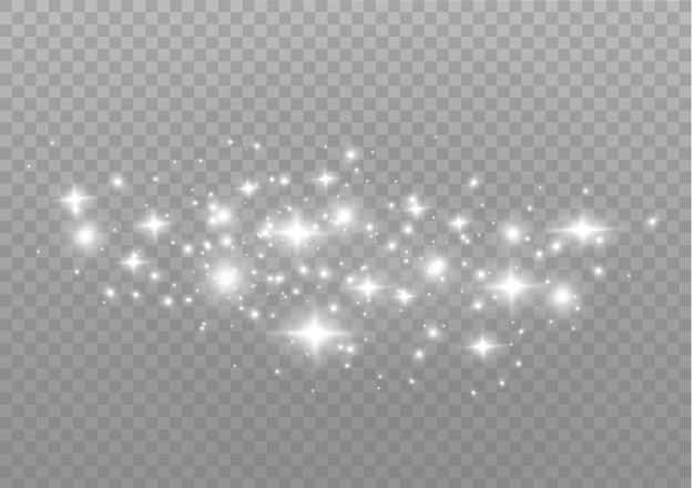 ほこりの火花と金色の星が特別な光で輝いています