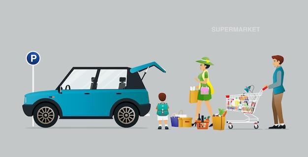 가족은 슈퍼마켓에서 자동차로 물건을 운반하고 있습니다.