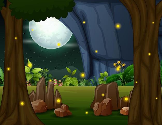 夜に自然の風景の中を飛んでいるホタル