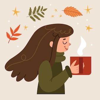 아늑한 스웨터를 입은 소녀는 마음으로 향기로운 커피를 들고 탑 뷰 가을 단풍