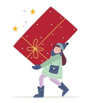 겨울 옷을 입은 소녀는 큰 선물을 가지고 있습니다.