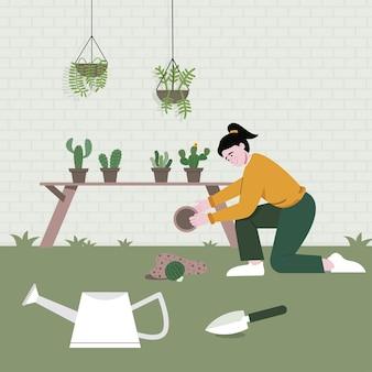 소녀는 정원의 식물을 조심스럽게 확인하고 있습니다.