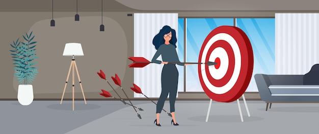 女の子は矢を持っています。矢印がターゲットに当たります。成功するビジネス、チームワーク、および目標の達成の概念。ベクター。