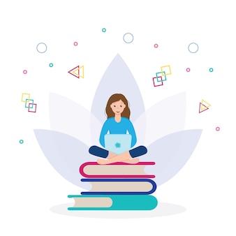 그 소녀는 손에 노트북을 들고 책 더미에 앉아 있다