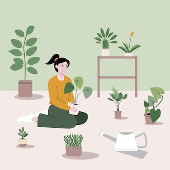 女の子はさまざまな種類の木や庭の材料と一緒に座っています。