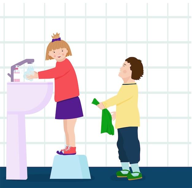 少女はトイレに立って、衛生の概念である石鹸で手を洗っています。