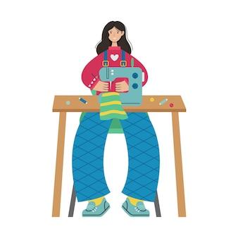 소녀는 재봉틀에 바느질을 합니다. 창조적 인 직업.