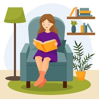 女の子は椅子に座って本を読むアームチェア付きのリビングルームのインテリア