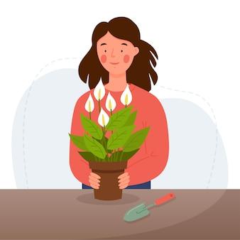 소녀 이식 집 식물 흰색 배경에 고립 꽃을 돌보는 여자