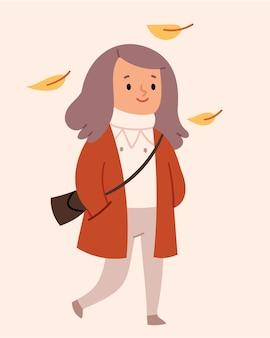 Девушка гуляет под осенними листьями