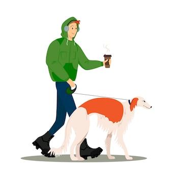 男は犬と一緒に歩き、コーヒーを飲みます男はグレイハウンドを歩きます