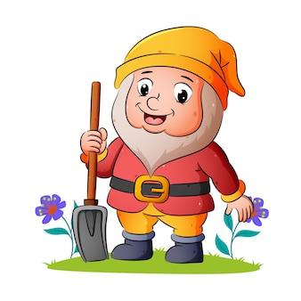 Счастливый гном держит лопату и широко улыбается в качестве иллюстрации.