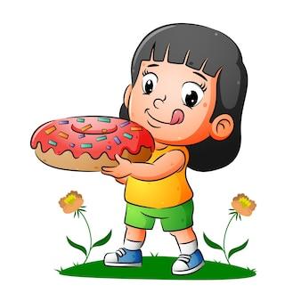 Счастливая девушка держит вкусные пончики с красочными беспорядками иллюстраций