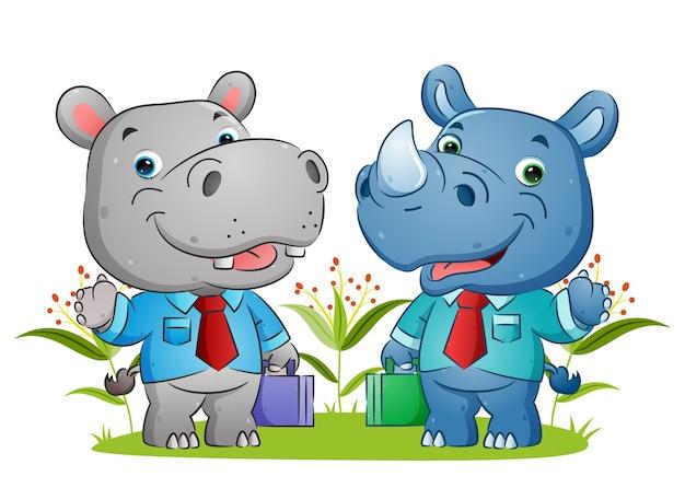 Бегемот и носорог разговаривают после работы в саду иллюстраций