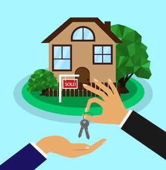 家は売られました。販売ホームコンセプト。全米リアルター協会加入者は、家の鍵を買い手に渡します。