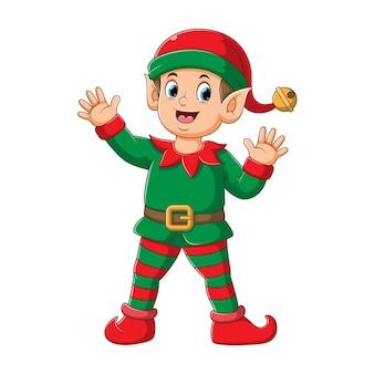 幸せそうな顔で立っているサンタ節のピエロの衣装を使用して男の子のエルフのイラスト