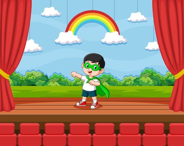 Иллюстрация мальчика, использующего супергероев, играет в театре