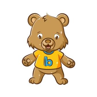 Стоит иллюстрация маленького медвежонка с желтой рубашкой и буквой b.