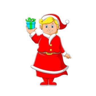 Иллюстрация женщины с желтыми волосами, держащей синюю коробку подарков на рождество