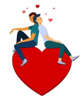 Влюбленный мужчина и мужчина сидят на большом сердце - символ любви.