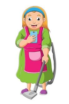 하녀는 삽화의 진공 청소기로 청소하는 동안 휴대폰을 하고 있다