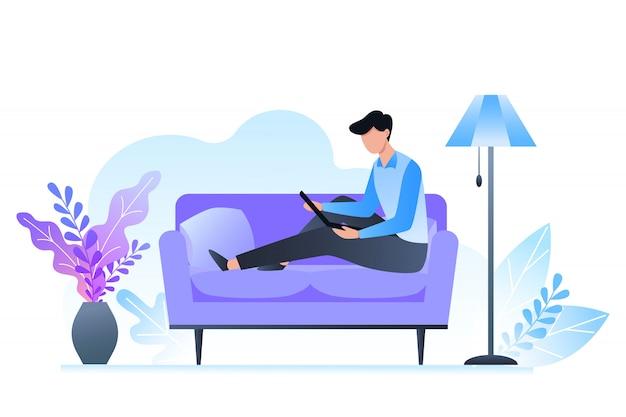 Мужчина сидит на диване и держит ноутбук, фрилансер и учится дома, интерьер комнаты в холодных тонах.