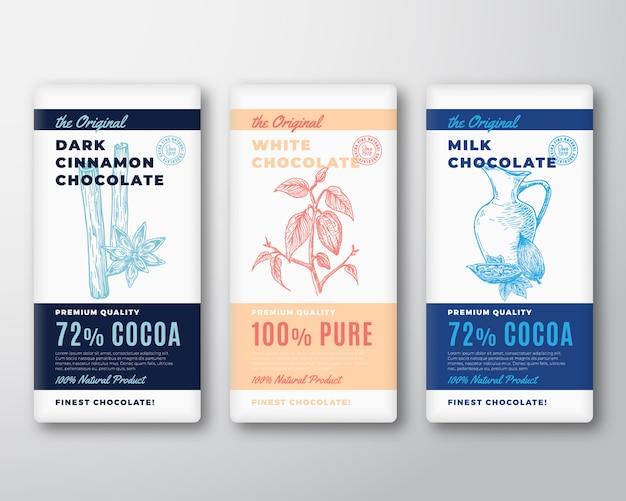 원래 최고의 초콜릿 추상 포장 디자인 라벨. 현대 타이포그래피와 손으로 그린 계피, 코코아 콩 및 우유 냄비 스케치 실루엣 배경 레이아웃.