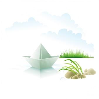 Бумажный кораблик на воде о траве.