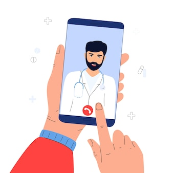 患者はオンラインで医師にビデオ通話を発信します。スマートフォンを持っている手。遠隔医療の概念。
