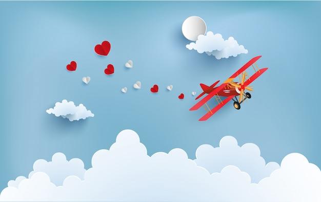 Самолет несет любовь, которая распространяется. есть любовь, пишущая баннеры.