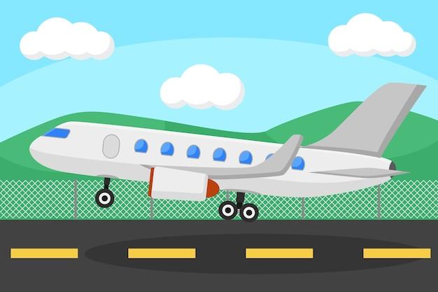 비행기는 자연을 배경으로 한 지역에서 이륙합니다.
