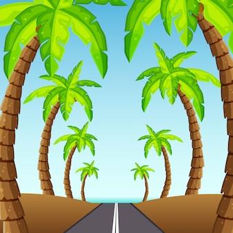 海に通じる道。ヤシの木がビーチの図につながる歩道をフレーミングします。
