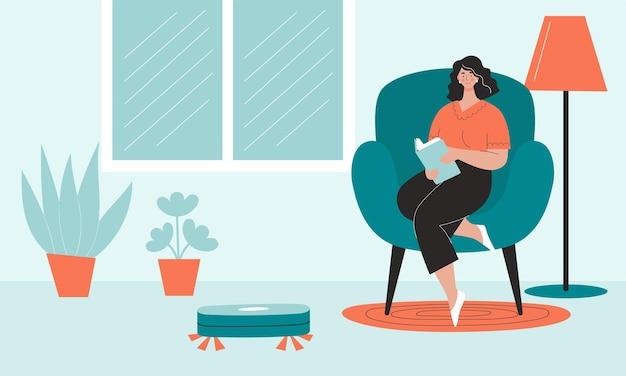 로봇 청소기는 여자가 책을 읽고 쉬는 동안 방을 청소한다.