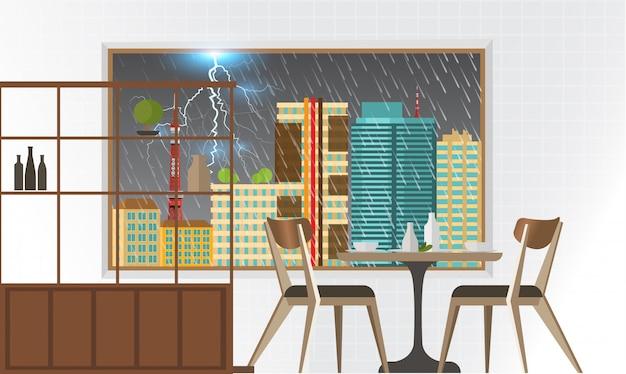 外の大雨の景色が見える部屋