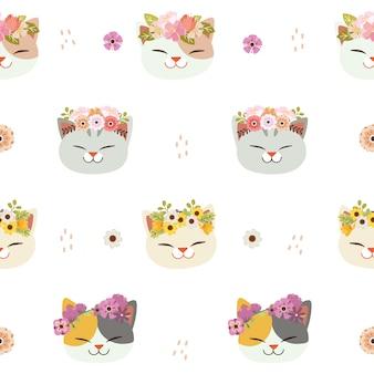 フラットスタイルの花の冠とかわいい猫のシームレスなパターン。