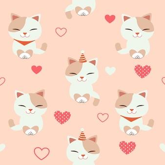 心でかわいい猫のシームレスパターン