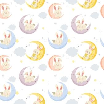 月が眠っているかわいいウサギのシームレスパターン