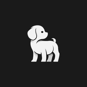 黒の背景に小さな犬のロゴのシンプルさ