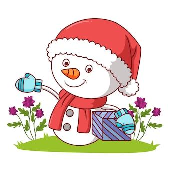 산타 모자를 쓴 눈사람이 삽화 선물을 들고 있다