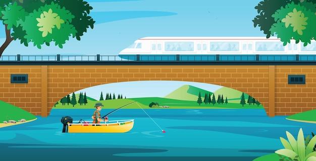 電車は漁師と一緒に川に架かる橋を走っていた