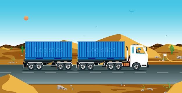 砂漠のある道を走るトラック