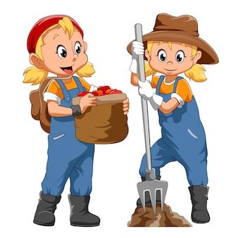 イラストの農夫の衣装を着た双子の女の子