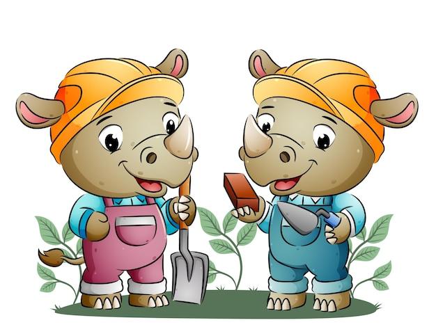 Два носорога держат лопату и красные кирпичи иллюстрации.